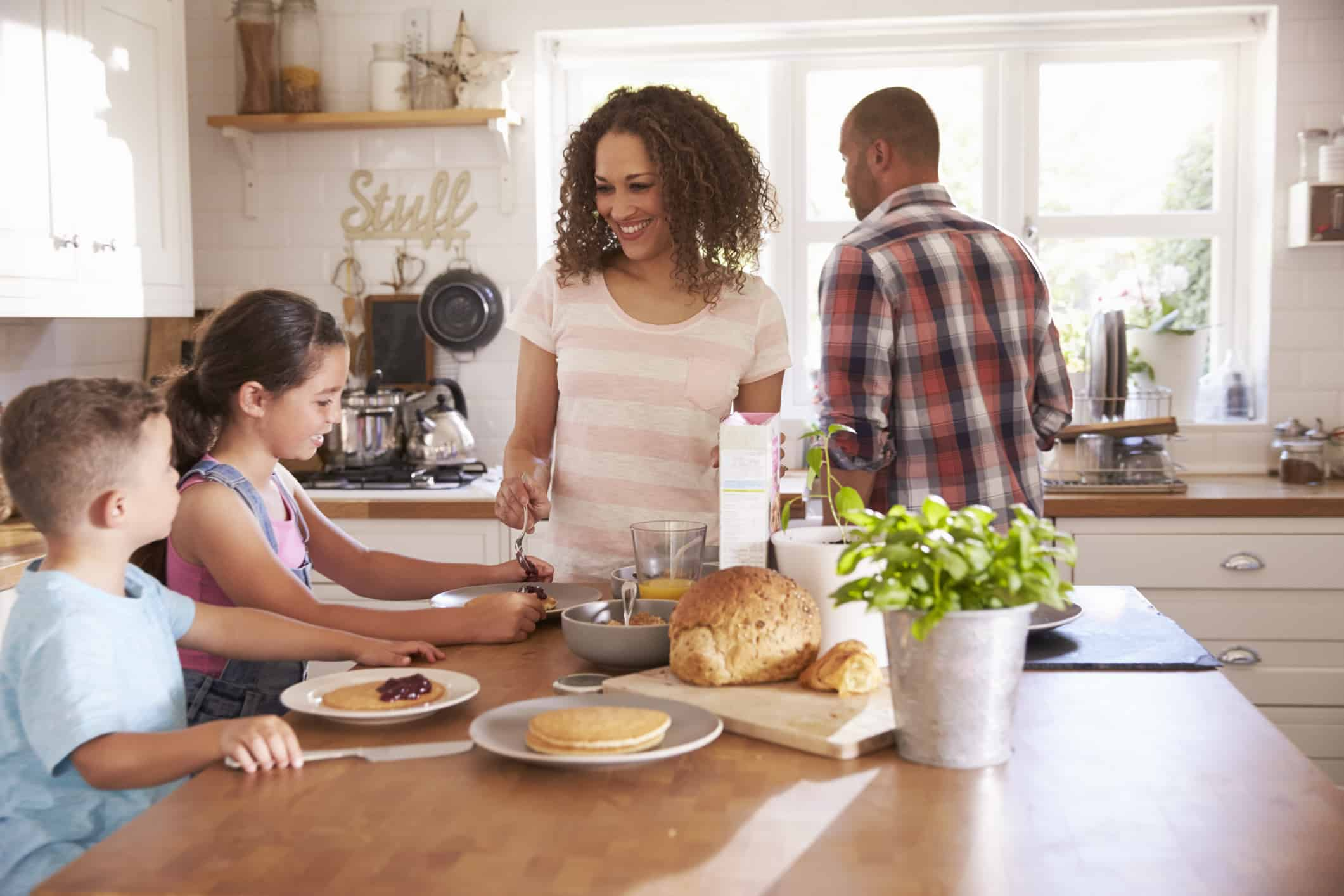 happy family cooking together in the kitchen for a healthier lifestyle